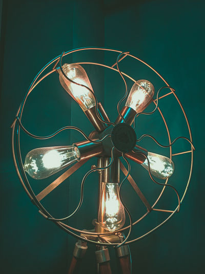 Close-up of illuminated antique electric fan