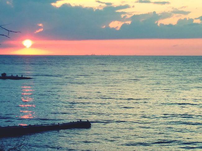 Water Sea Sunset Beach Multi Colored Red Wave Sand Summer Sun Romantic Sky Coastal Feature Jet Boat Refraction Dramatic Sky Storm Cloud Spectrum Coastline Atmospheric Mood Seascape Low Tide Tide Calm Buoy Moody Sky