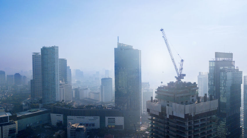 Architecture Building Building Exterior Built Structure City Cityscape Construction Industry Crane - Construction Machinery Development Financial District  High Industry Machinery Modern Nature No People Office Building Exterior Outdoors Pollution Sky Skyscraper Tall - High Tower