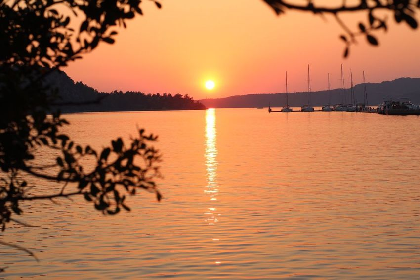 Sunset Reflection Sun Beauty In Nature Orange Color Water Nature Scenics Sky Silhouette Tranquility Waterfront Lake Tranquil Scene Outdoors No People Mountain Tree Marmaris