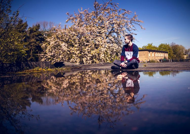 reflections Tree Reflection Real People Water Tree One Person Plant Lake Sky Sitting Men Lifestyles Beauty In Nature