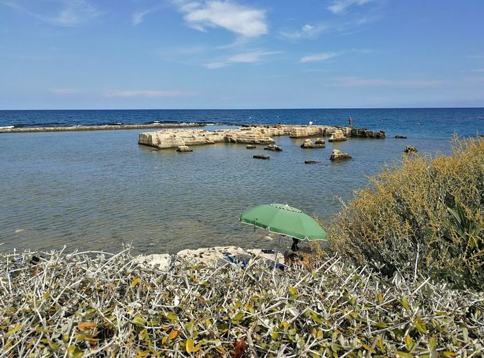Water Sea Beauty In Nature Sky Plant Tranquility Scenics - Nature Tranquil Scene Horizon Over Water Nature Horizon Land Beach No People Day Cloud - Sky Flower Non-urban Scene Growth Polignano A Mare Ombrellone Da Spiaggia Turisti Scogliera Estate Adriatic Sea