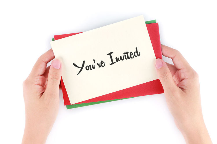 Cropped hands holding card with text on white background