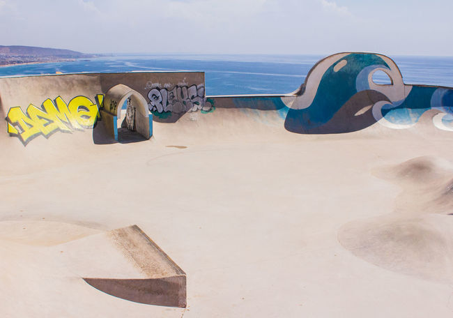 Skate Park in Morocco Morocco Morocco Travel MoroccoTrip Skateboarding Skatepark Taghazout Beach Beach Beauty In Nature Flip-flop Horizon Land Nature No People Sand Scenics - Nature Sea Skate Park Skateboard Sky Slipper  Taghazout Taghazout Surfing Tranquil Scene Tranquility Water