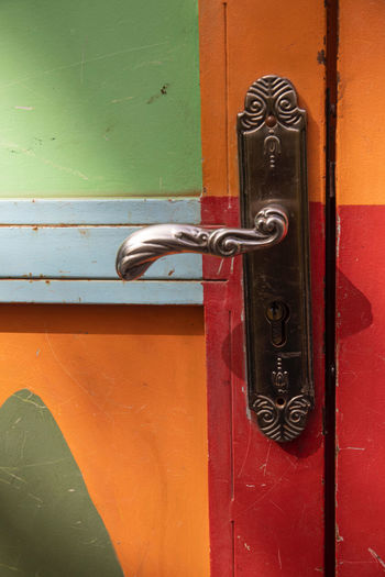 a very imaginative garden space outside of Marrakech, Morocco with beautiful and colourful objects blending with the garden Garden Park Colorful ArtWork Trees Path Imaginative Marrakech Morocco Anima Garden Textured  Door Entrance Metal Safety No People Protection Security Lock Close-up Closed Day Architecture Doorknob Red Handle Built Structure Knob Outdoors Latch Wood - Material Silver Colored
