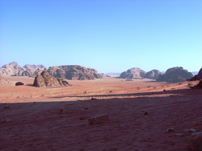 Scenics - Nature Rock Sky Environment Rock - Object Tranquil Scene Landscape Desert Solid Mountain Beauty In Nature Arid Climate Tranquility Non-urban Scene Rock Formation Climate Land Clear Sky Copy Space No People Mountain Range Outdoors Eroded Formation Sandstone Wadi Rum Wadi Rum JORDAN Wadi Rum National Park, Jordan Jordan Jordan Middle East