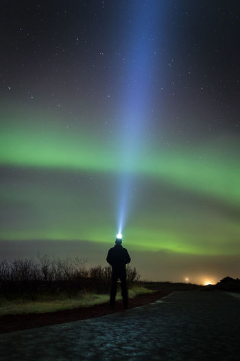 My first Northern Lights on Iceland Iceland Golden Circle Night One Person Silhouette Star - Space Astronomy Dramatic Sky Landscape Sky Nature Canon Canon6d Photooftheday Photography 16-35mm F4L Travel Tourism Silhouette Dramatic Sky Northern Lights Iceland Aurora Borealis