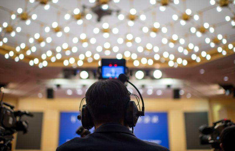 Rear view of man wearing headphones while working in studio