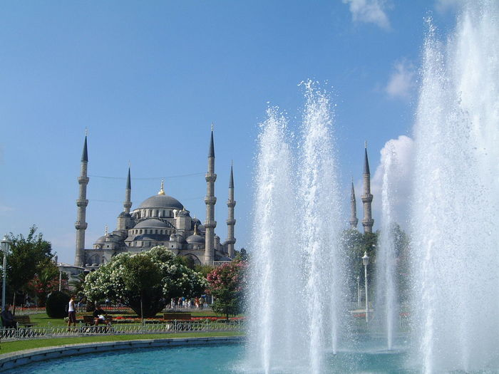 Blue Mosque & Fountain Architecture Blue Mosque Blue Sky Building Exterior Capital Cities  City Composition Famous Place Fountain Incidental People International Landmark Istanbul Minarets Minaretsofworld Outdoor Photography Place Of Worship Religion Spirituality Spraying Tourism Tourist Attraction  Travel Destinations Trees Turkey Water