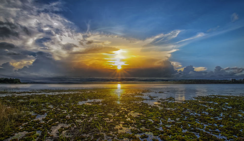 sunset tok uban lake golden sand kelantan with relection Sunset Cloud - Sky Sun Water Sky Reflection Sunlight Scenics Beauty Gold Colored Landscape Summer Lake Outdoors Nature Tranquility Mountain No People Blue Beauty In Nature