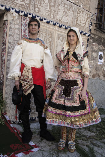 Lagartera costumes, Toledo, Spain Costumes Casual Clothing Day Enjoyment España Front View Full Length Fun Happiness Lagartera Lagartera Costumes Lagarterana Leisure Activity Lifestyles Outdoors Person Portrait Smiling SPAIN Toledo Toledo Spain Toothy Smile Warm Clothing