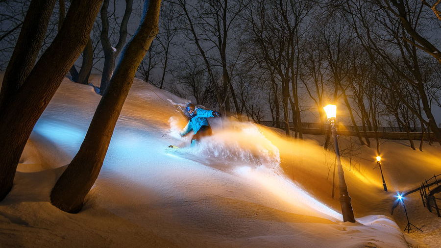 People on snow covered land at night
