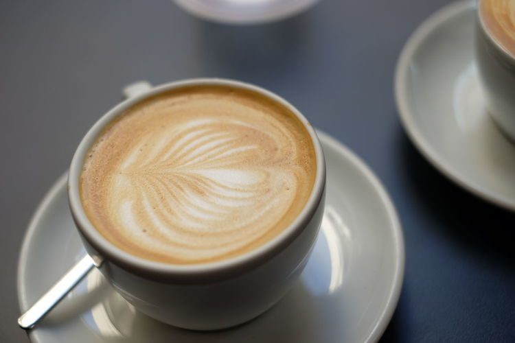 Close-Up Of Froth Art On Coffee Served In Restaurant