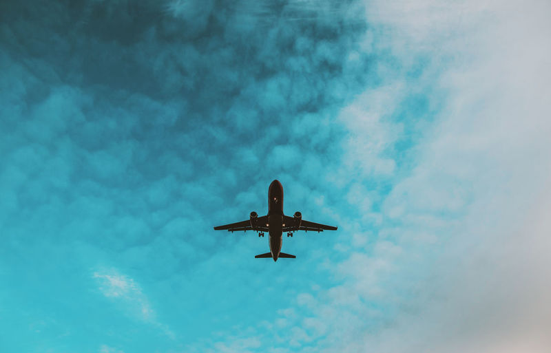 Budapest Hungary Plane Sky And Clouds Traveling Air Vehicle Airplane Cloud - Sky Flying Journey Low Angle View Sky Sky_collection Transportation Travel
