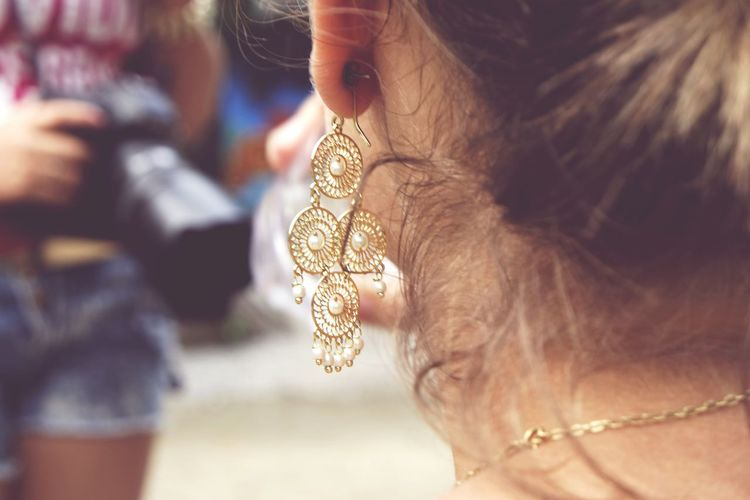 Close-up of woman wearing earring