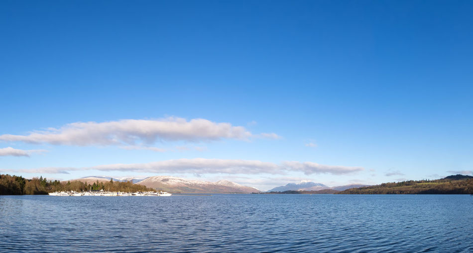 Scotland Beauty In Nature Ben Lomond Blue Boats Cloud - Sky Day Famous Place Freshwater Lake Landscape Loch Lomond Moorings  Mountain Nature No People Outdoors Pleasure Craft Scenics Sky Tranquil Scene Tranquility Tree Water Wilderness Area