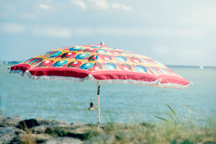 Beauty In Nature Close-up Cloud - Sky Day Focus On Foreground Ijsselmeer Lake View Longing For Summer Meer Multi Colored Nature No People Outdoors Parasol Sky Summer Feeling Summer Vibes Summer ☀ Summertime Sunshine Swimming Tranquil Scene Tranquility Warm Day Water