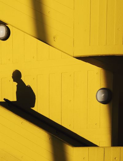 Yellow Door Shadow Sunlight Real People Day One Person Built Structure Indoors  Architecture Close-up People Silhouette The Week On EyeEm Paint The Town Yellow Postcode Postcards