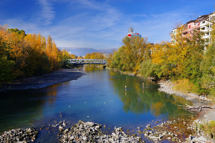 View Of Bridge Over River During Autumn