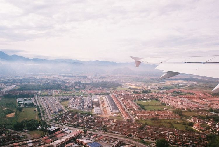 shot on film: Ipoh, Malaysia Architecture TOWNSCAPE Small Town Residential District View From Above View From The Window... View From An Airplane Ipoh Ipoh,Malaysia Malaysia Film Film Photography Filmisnotdead Flying Aerial View High Angle View Cloud - Sky Mountain Countryside