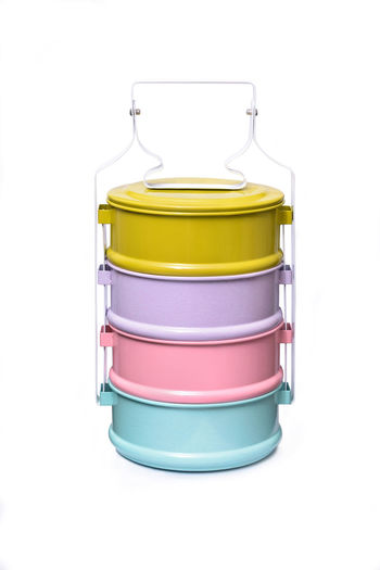 Colorful tiffin, food carrier isolated on white background Container Convenience Isolated Lunch Native Picnic Pink TIFFIN Blue Buddhists Carrier Colorful Countryside Cylindrical Food Holders Lifestyles Multi-colored Single Object Southeast Asian Food Stacked Still Life Violet White Background Yellow