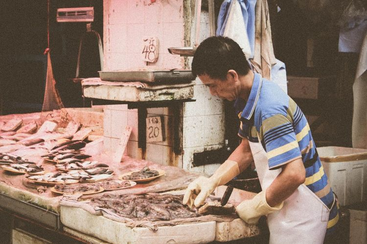 Food And Drink Casual Clothing Person Food Preparation  Freshness Day Retail  FishMarket Fish Market