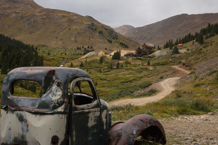 Sep 2018 - Animas Forks Abandoned Beauty In Nature Damaged Day Environment Field Ghost Town Land Land Vehicle Landscape Mining Camp Mode Of Transportation Motor Vehicle Mountain Nature No People Non-urban Scene Obsolete Outdoors Ruined Scenics - Nature Sky Transportation Truck
