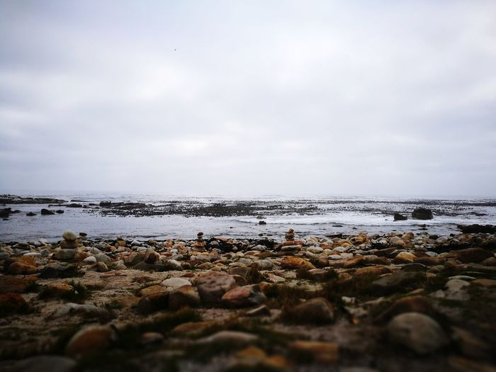 Cape Of Good Hope, Cape Town,South Africa Beach Cloud - Sky Outdoors Tranquility Pebble Nature Wave Beauty In Nature Low Tide