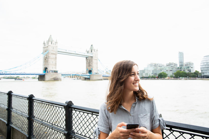London London lifestyle Tower Bridge  Travel Traveling Bridge Bridge - Man Made Structure Cell Phone  City Communication Mobile Device One Person Real People Technology Wireless Communication Wireless Technology Young Adult Young Women