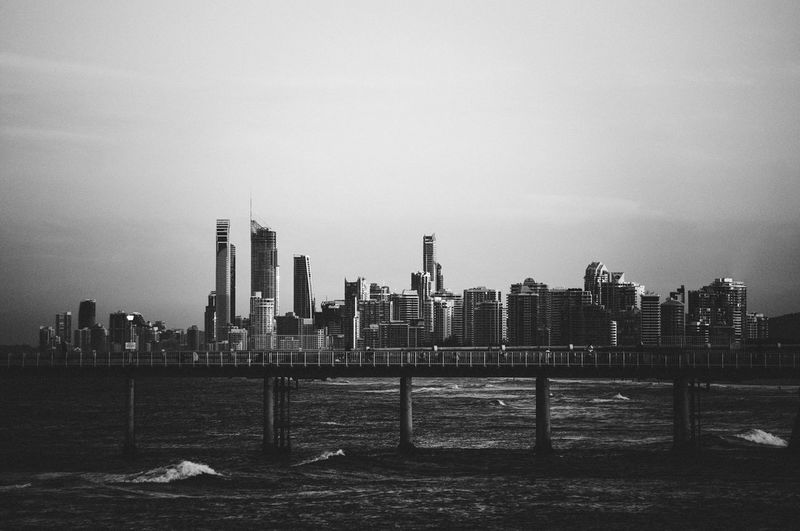 Bridge and cityscape against sky