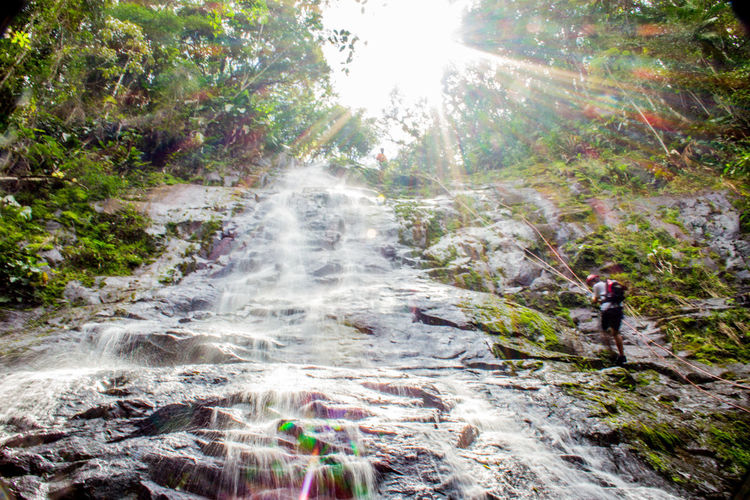 Ecoturismo Meleiro, Brazil Turismo De Aventura Adult Adults Only Adventure Beauty In Nature Climbing Day Ecoturism Extreme Sports Forest Helmet Lens Flare Men Motion Nature One Man Only One Person Only Men Outdoors People Rock - Object Scenics Sunlight Tree Waterfall