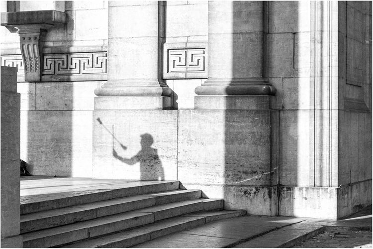 Shadow of man on historic building