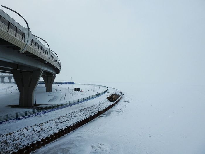 Финский залив The Gulf Of Finland Ice WHiTE WORLD Bridge Road Sankt-Petersburg Colors Of Sankt-Peterburg Russia Walking Around Big City Life Sea Snowing ❄ Winter Cold Temperature Snow No People Architecture Built Structure Outdoors Nature Day The Graphic City