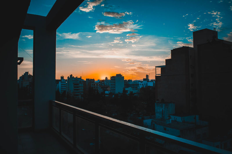 Architecture Building Building Exterior Built Structure City Cityscape Cloud - Sky Nature No People Office Building Exterior Orange Color Outdoors Railing Residential District Silhouette Sky Skyscraper Sunset Transparent Window