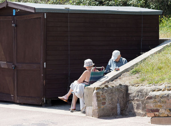 Frinton seafront beach hut Adult Adults Only Architecture Beach Hut Building Exterior Built Structure Day Frinton-on-Sea Full Length Lifestyles Men Outdoors People Real People Seaside Town Togetherness Two People Women Young Adult Young Women