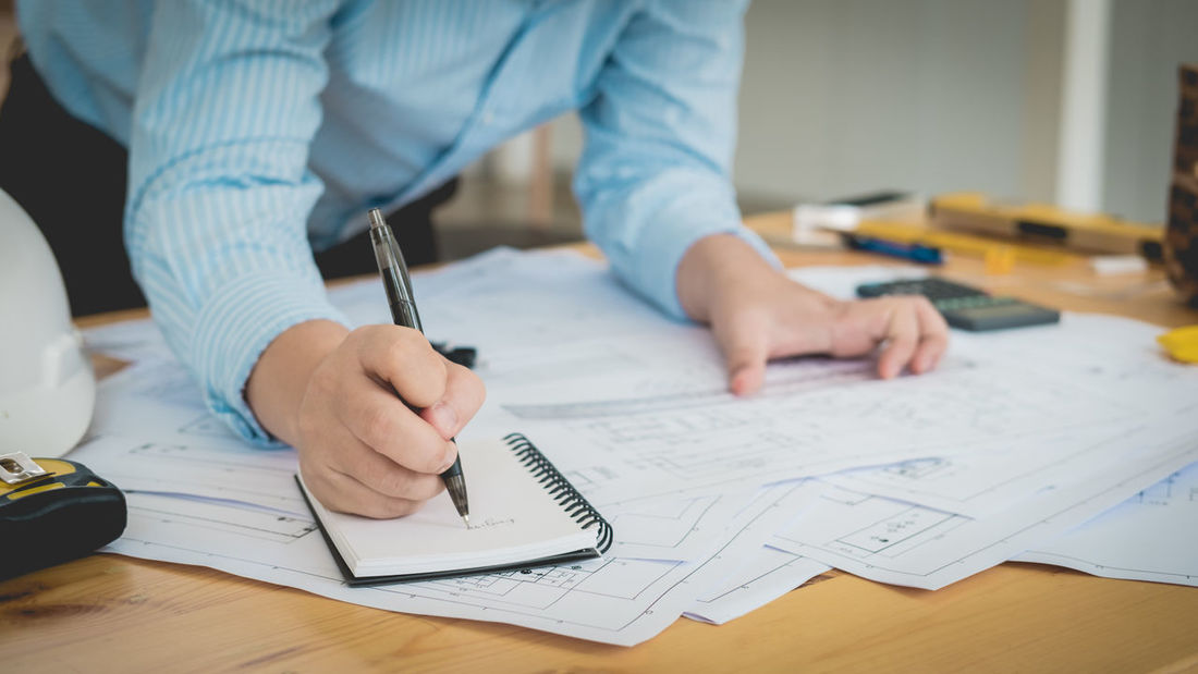 Business Calculator Close-up Creativity Desk Drawing - Activity Focus On Foreground Human Hand Indoors  Men Occupation One Person Paper Paperwork Pen Pencil Plan Planning Real People Sketch Skill  Table Technology Working Writing