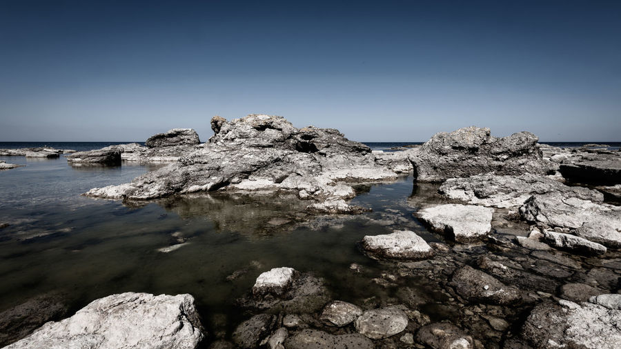 Beach Beauty In Nature Clear Sky Copy Space Day Eroded Land Langhammars Nature No People Non-urban Scene Outdoors Rauk Rock Rock - Object Rock Formation Salt Flat Scenics - Nature Sea Sky Solid Tranquil Scene Tranquility Water Wide Angle