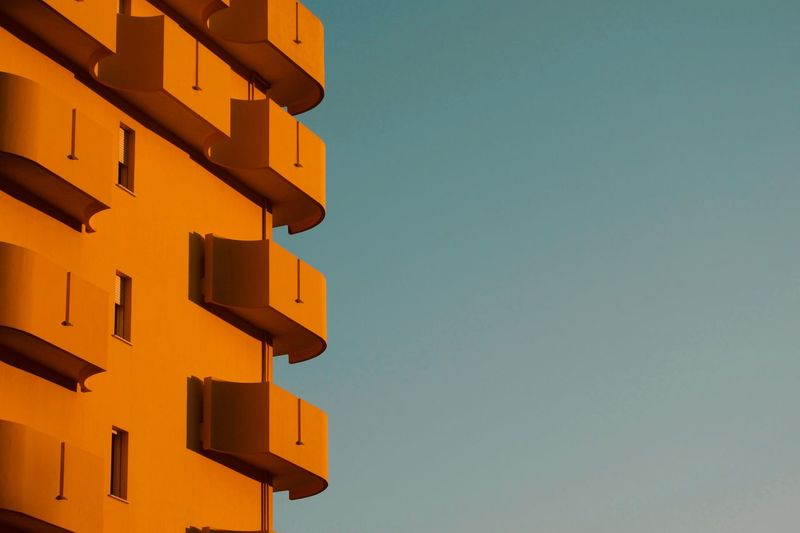 Low Angle View Of Orange Tower Against Clear Sky
