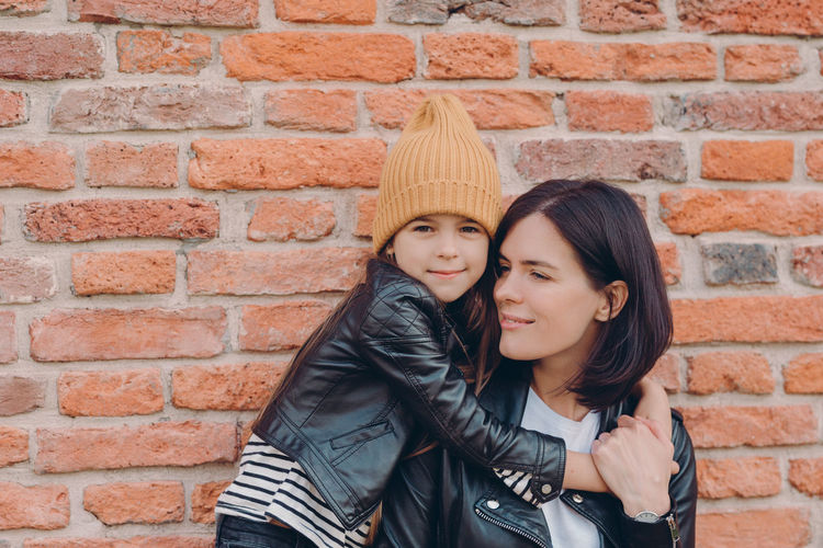 Portrait of girl embracing mother
