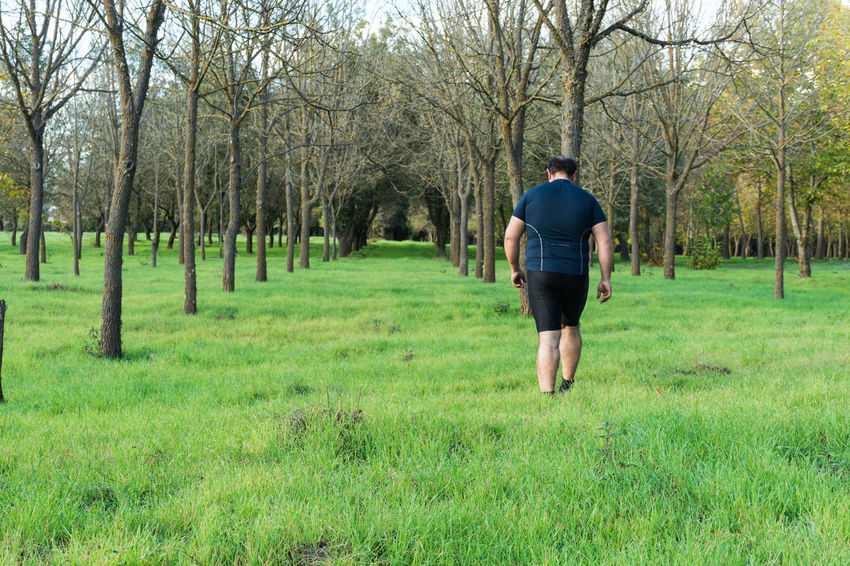 Obesity Adults Only Bare Tree Beauty In Nature Day Field Full Length Grass Lifestyles Men Nature Obese Obese Boy Obese Man Obese Woman Obessed One Man Only One Person Outdoors Overweight People Real People Rear View Tree Walking