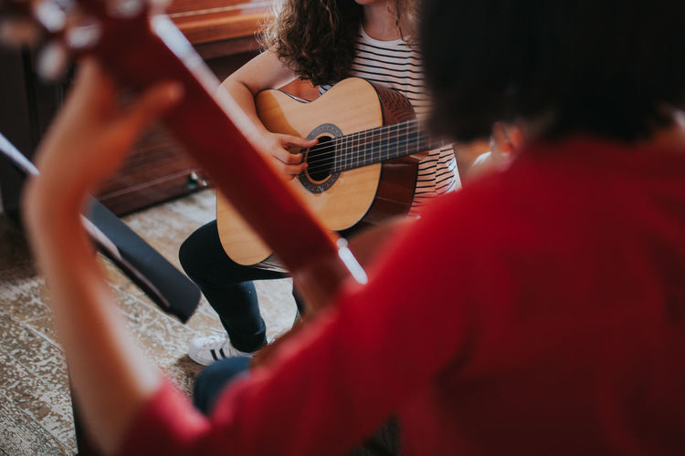 Guitar Lessons Learning Music Skill  Teaching Artist Arts Culture And Entertainment Guitar Guitar Love Guitar Player Guitarist Leisure Activity Music music brings us together Music School Musical Musical Equipment Musical Instrument Musical Instrument String Musical Instruments Musician Playing Real People String Instrument Women