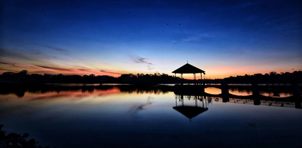 End of Light Reflection Water Sunset Beauty In Nature Nature Scenics Tranquil Scene Tranquility Silhouette Blue Sky Idyllic EyeEmNewHere Singapore 🇸🇬 Night