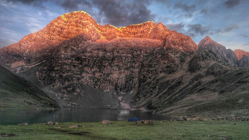 Mount Harmukh || Kashmir Lake Landscape Mountain Outdoors Cloud - Sky Nature Water Tranquility Beauty In Nature Scenics Sky No People Mountain Range Sunset Tree Grass Day Galaxy Astronomy Natgeoyourshot Gettyimages Kashmirdiaries Dailylifekashmir EyeEm Masterclass Mountainscape