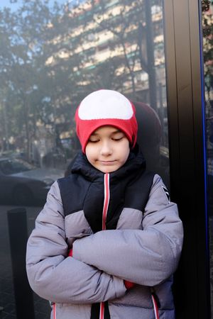 Not the same. // One Person Childhood Hood - Clothing Hooded Shirt Front View Outdoors Day Warm Clothing Knit Hat Leisure Activity Real People Elementary Age Lifestyles Portrait Winter Children Only Cap Child Looking At Camera