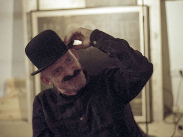 Portrait of man wearing hat at home