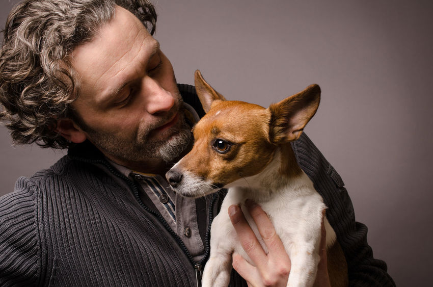 Man with his friend Adults Only Affectionate Bonding Close-up Dog Domestic Animals Friendship Headshot Indoors  Jack Russell Terrier Mammal Mature Men One Animal One Man Only One Mature Man Only One Person Only Men People Pets Real People Studio Shot Young Adult