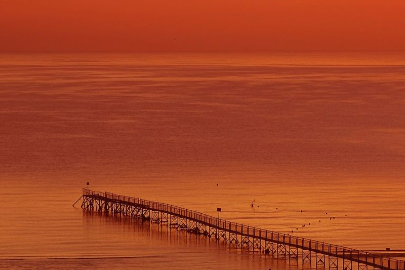 Sunrise Pier Travel Travel Destinations Scenics - Nature Environment Sky Landscape Land Nature Agriculture Beauty In Nature Rural Scene Sunset Orange Color Non-urban Scene Tranquil Scene Idyllic No People Outdoors Plant Tranquility Field Day