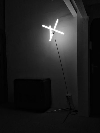 Electric lamp against wall at home