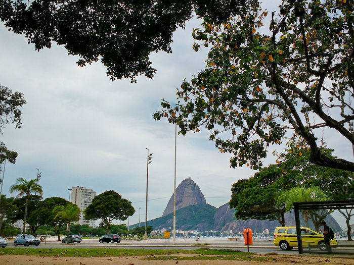 Alternative view of Sugarloaf moutain from Botafogo. Botafogo Car City Life Cloud - Sky Day Land Vehicle Landscape Mountain Nature Outdoors Sky Sugarloaf Tranquil Scene Transportation Tree Trees