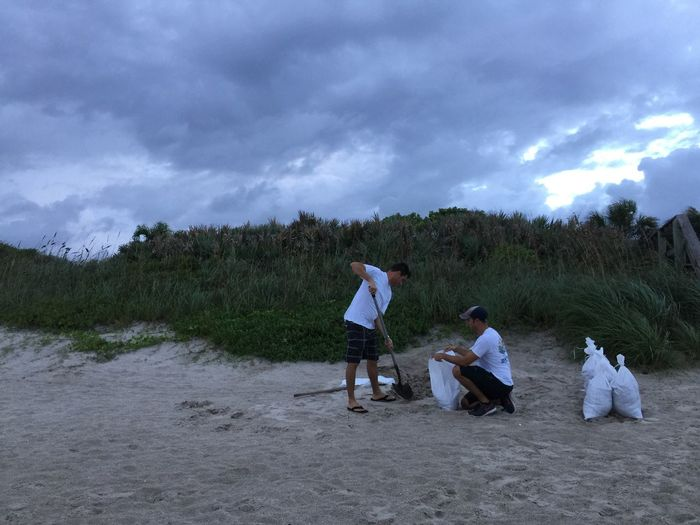 Filling sand bag in preparation for Hurricane Matthew 2016 Melbourne Beach, FL Hurricane Matthew Sand Sand Bags Hurricane Preps